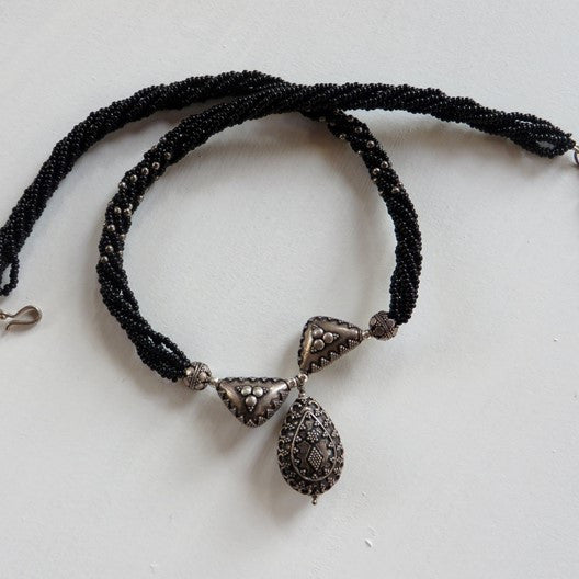 black beads and silver necklace