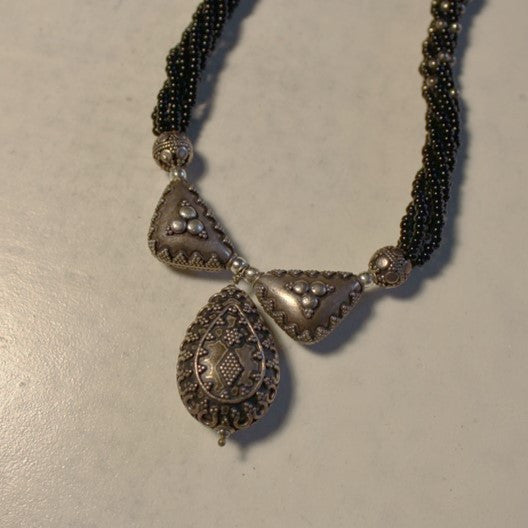 black beads and silver pendant necklace