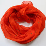 bright orange scarves