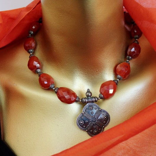 silver pendant and carnelian gemstone necklace