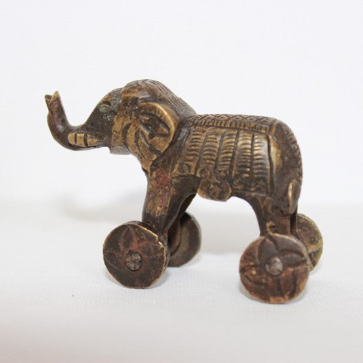 brass elephant toy on rolling wheels