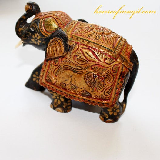 gold and red hand crafted wooden elephant