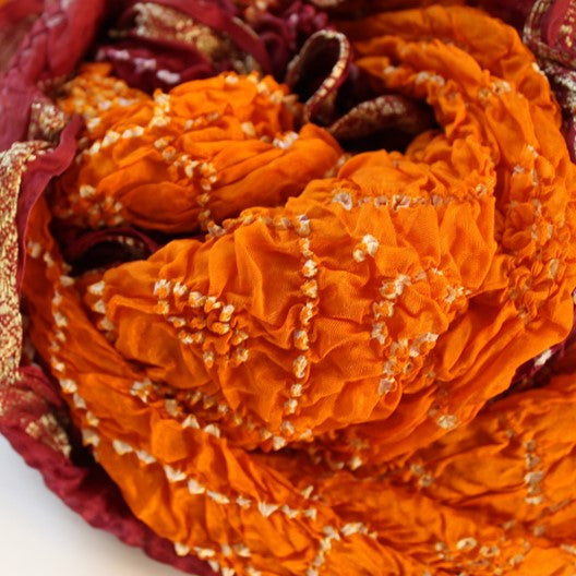orange and burgundy scarf