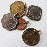 paise coins as charms