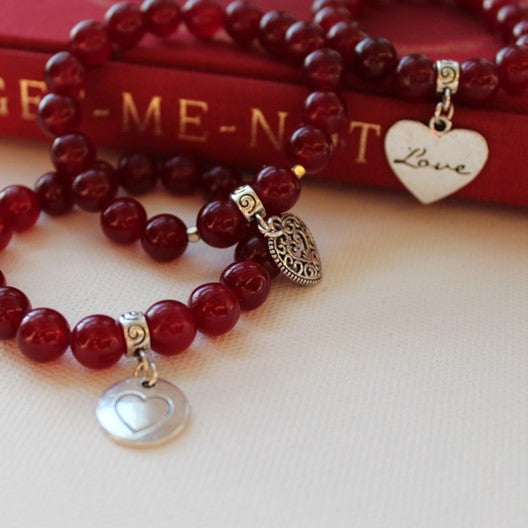 red jade bracelet with love charm