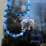 blue necklace with elephant pendant