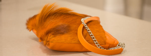 sherene melinda orange multiway leather handbag