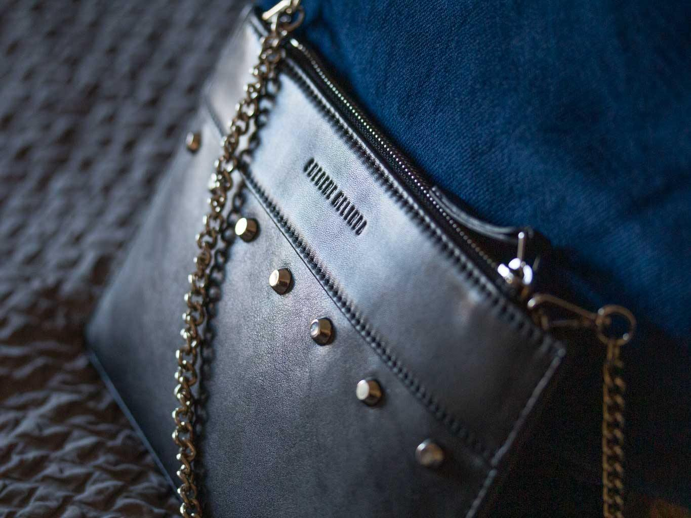 Clutch Studded Handbag in Black by Sherene Melinda