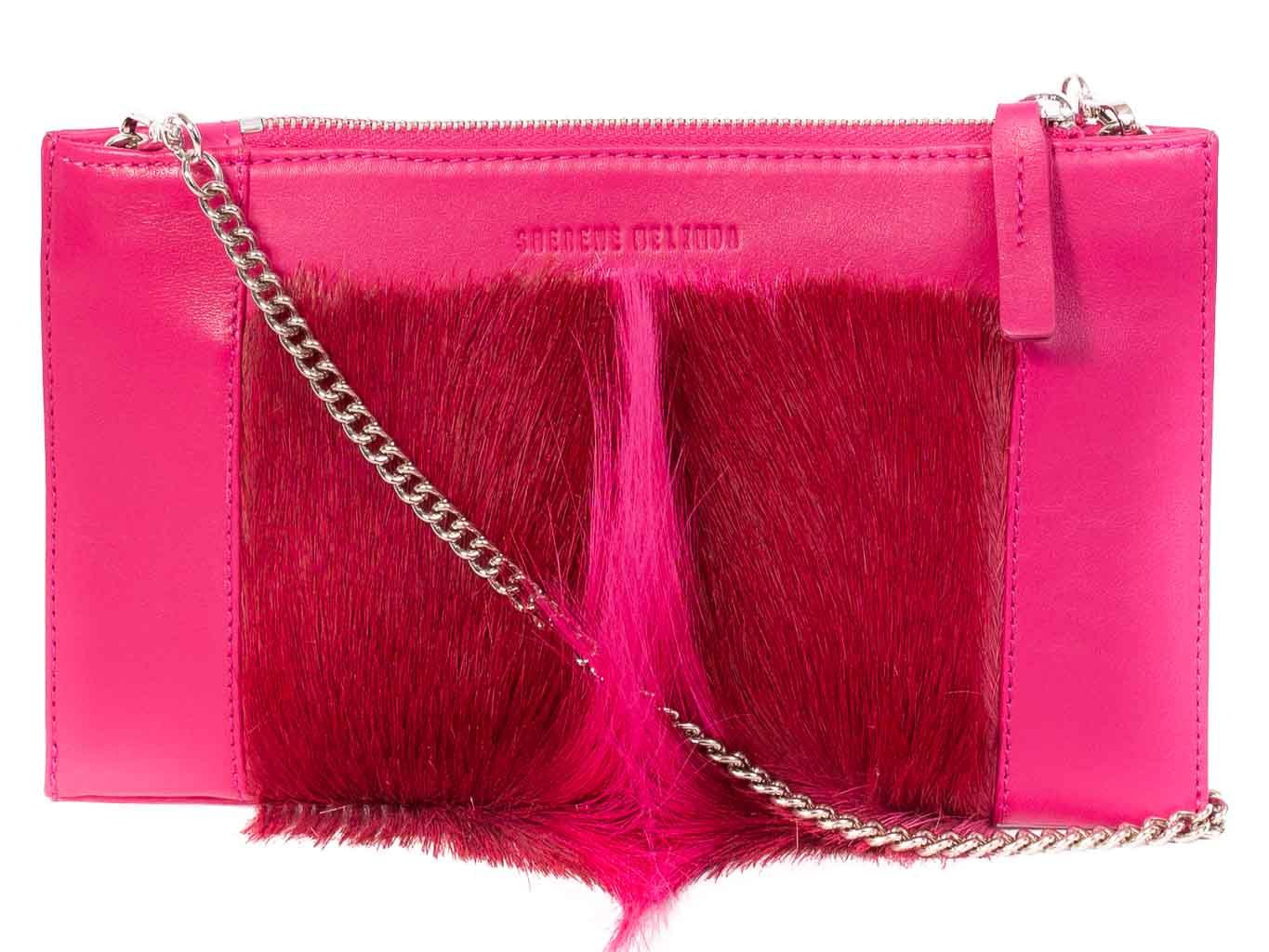 Clutch Springbok Handbag in Fuchsia with a fan feature by Sherene Melinda front strap