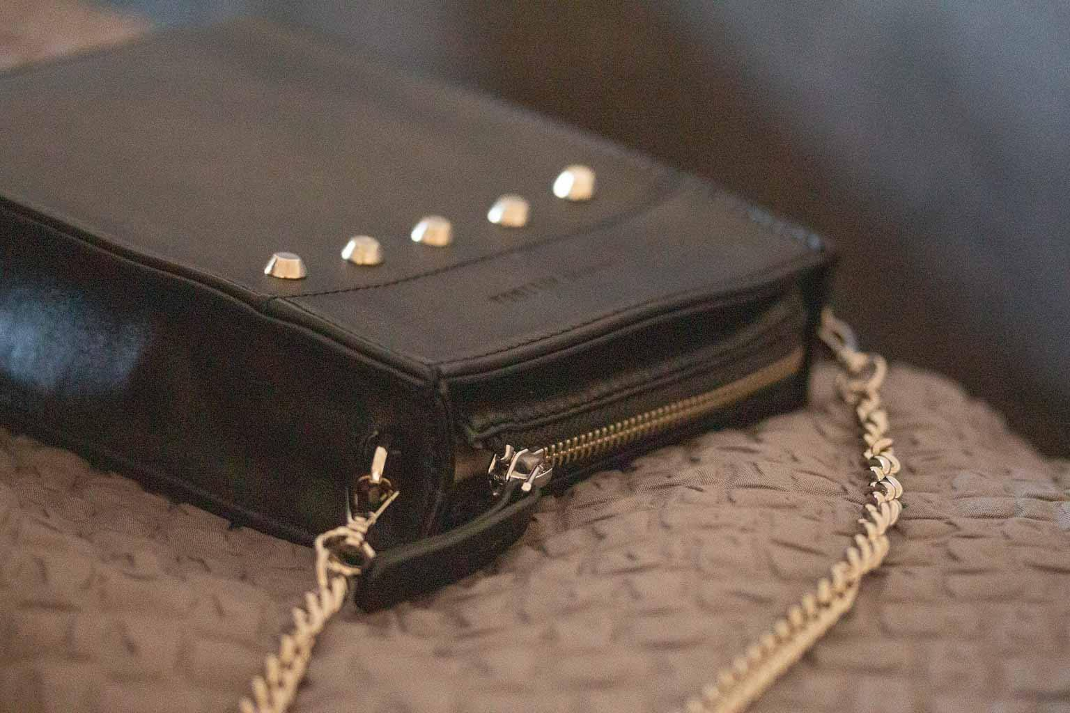 Messenger Studded Handbag in Black by Sherene Melinda side angle
