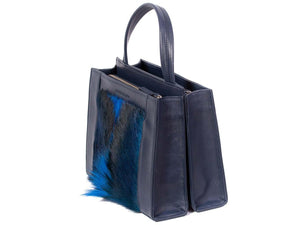 Top Handle Springbok Handbag in Navy Blue with a fan feature by Sherene Melinda side angle