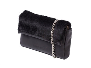 sherene melinda springbok hair-on-hide black leather Sophy SS18 Clutch Bag Stripe side angle