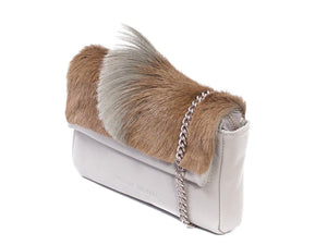 sherene melinda springbok hair-on-hide earth leather Sophy SS18 Clutch Bag Fan side angle strap