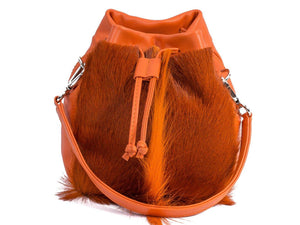 sherene melinda springbok hair-on-hide orange leather pouch bag Fan front