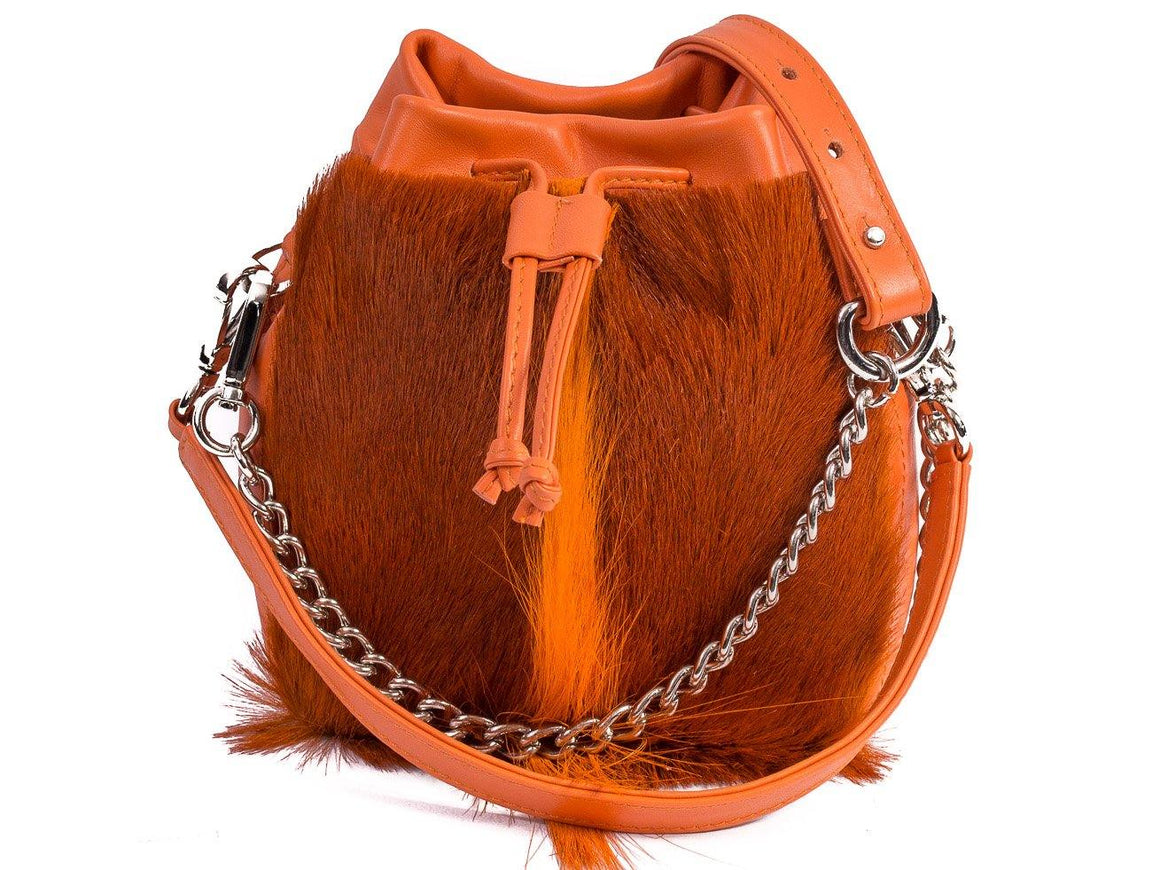 sherene melinda springbok hair-on-hide orange leather pouch bag fan front strap