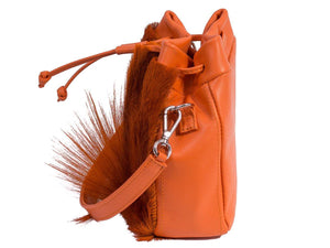sherene melinda springbok hair-on-hide orange leather pouch bag Fan side