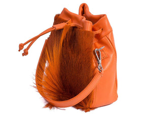sherene melinda springbok hair-on-hide orange leather pouch bag Fan side angle