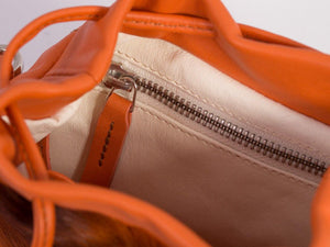 sherene melinda springbok hair-on-hide orange leather pouch bag inside