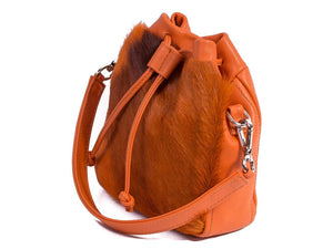 sherene melinda springbok hair-on-hide orange leather pouch bag Stripe side angle