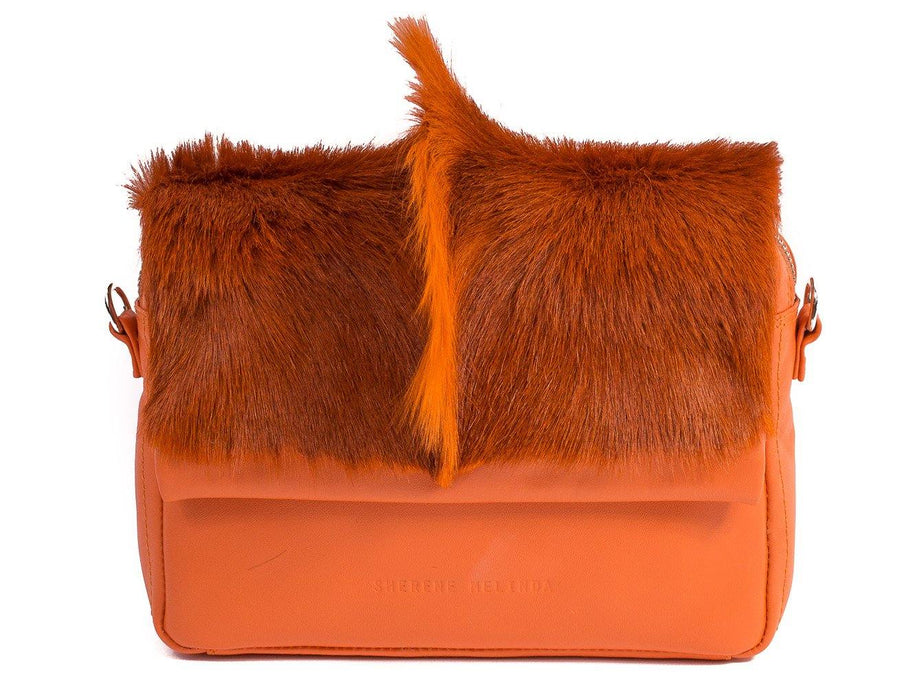 sherene melinda springbok hair-on-hide orange leather shoulder bag fan front strap