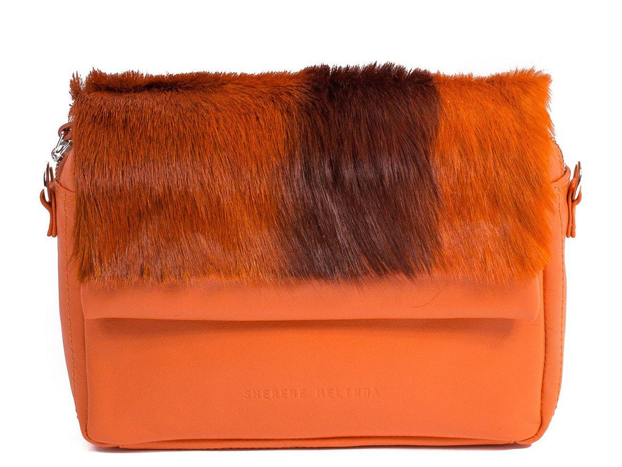 sherene melinda springbok hair-on-hide orange leather shoulder bag stripe front strap