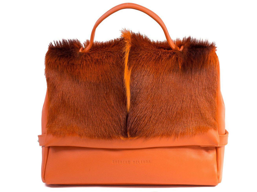 sherene melinda springbok hair-on-hide orange leather smith tote bag fan front strap