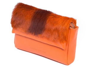 sherene melinda springbok hair-on-hide orange leather Sophy SS18 Clutch Bag Stripe side angle
