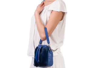sherene melinda springbok hair-on-hide royal blue leather pouch bag fan context