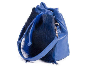 sherene melinda springbok hair-on-hide royal blue leather pouch bag Fan side angle