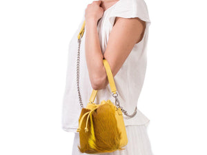 sherene melinda springbok hair-on-hide yellow leather pouch bag fan context