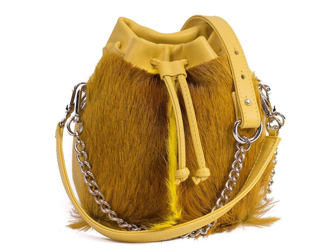 sherene melinda springbok hair-on-hide yellow leather pouch bag fan front strap