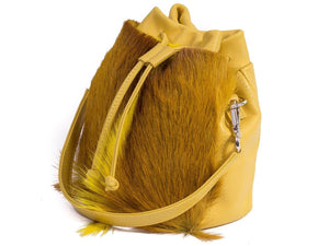 sherene melinda springbok hair-on-hide yellow leather pouch bag Fan side angle