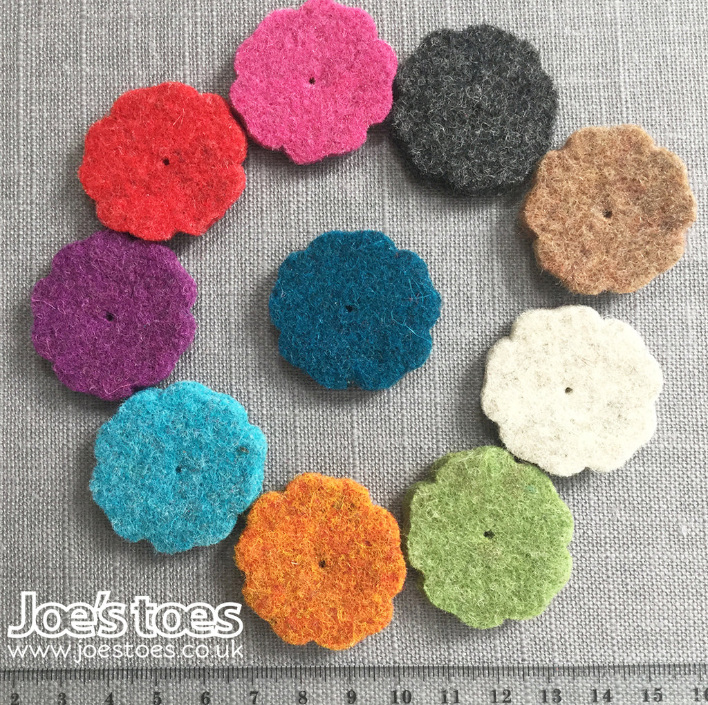small flowers in thick wool felt in ten different colours