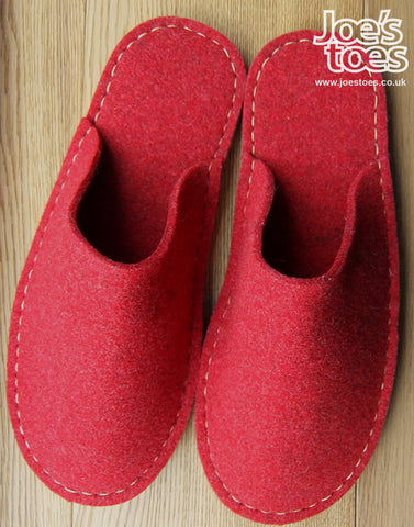 Red slipper with green/grey sole