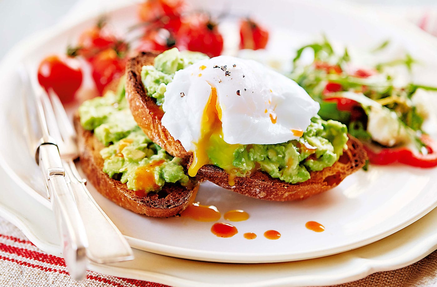 Poached Eggs with Smashed Avocado and Tomatoes