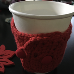 button-closure. crochet. adjustable sleeve for cup