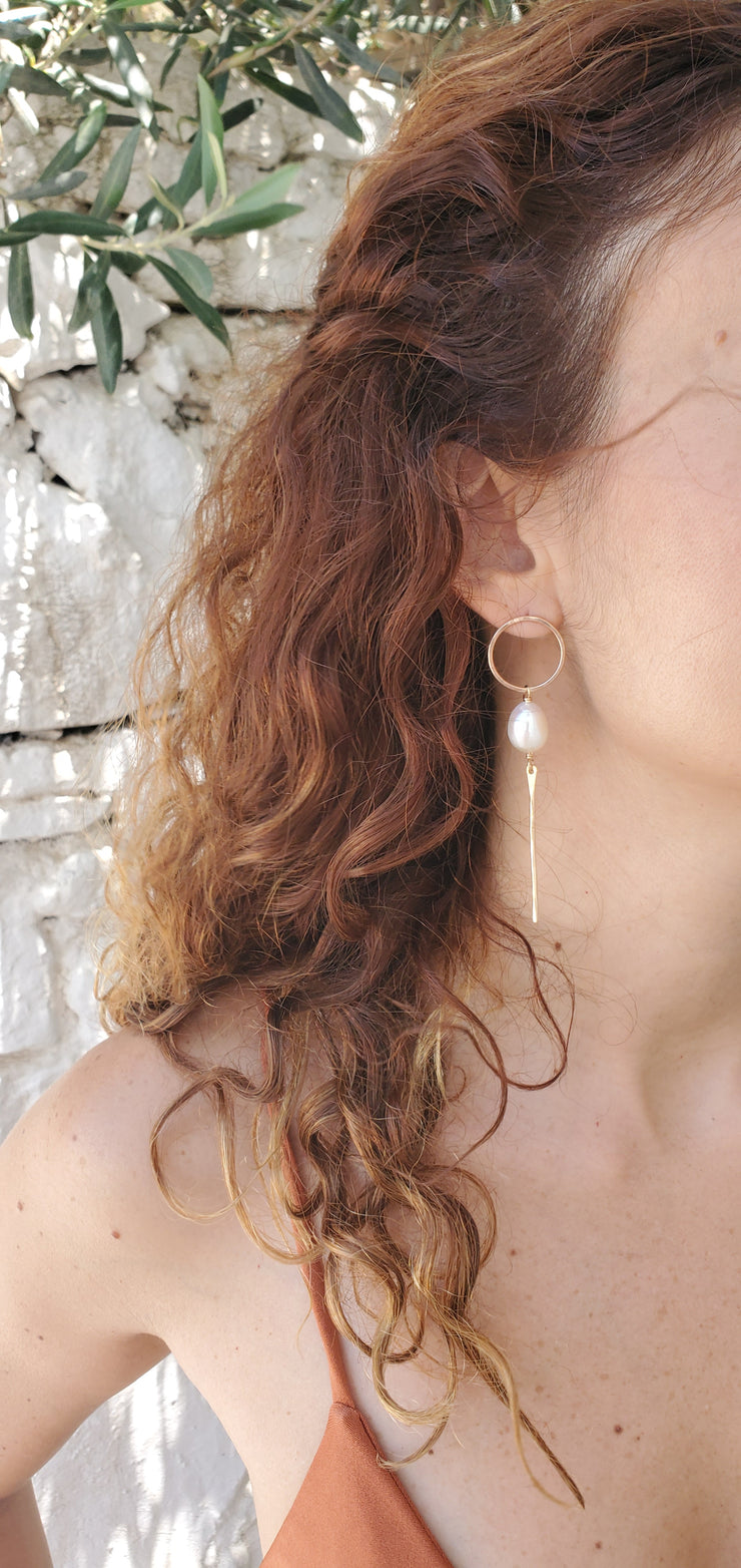 Delphi Earrings on a model