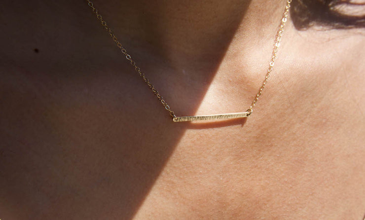 Albisia Jewelry - Ava Bar Necklace on a model