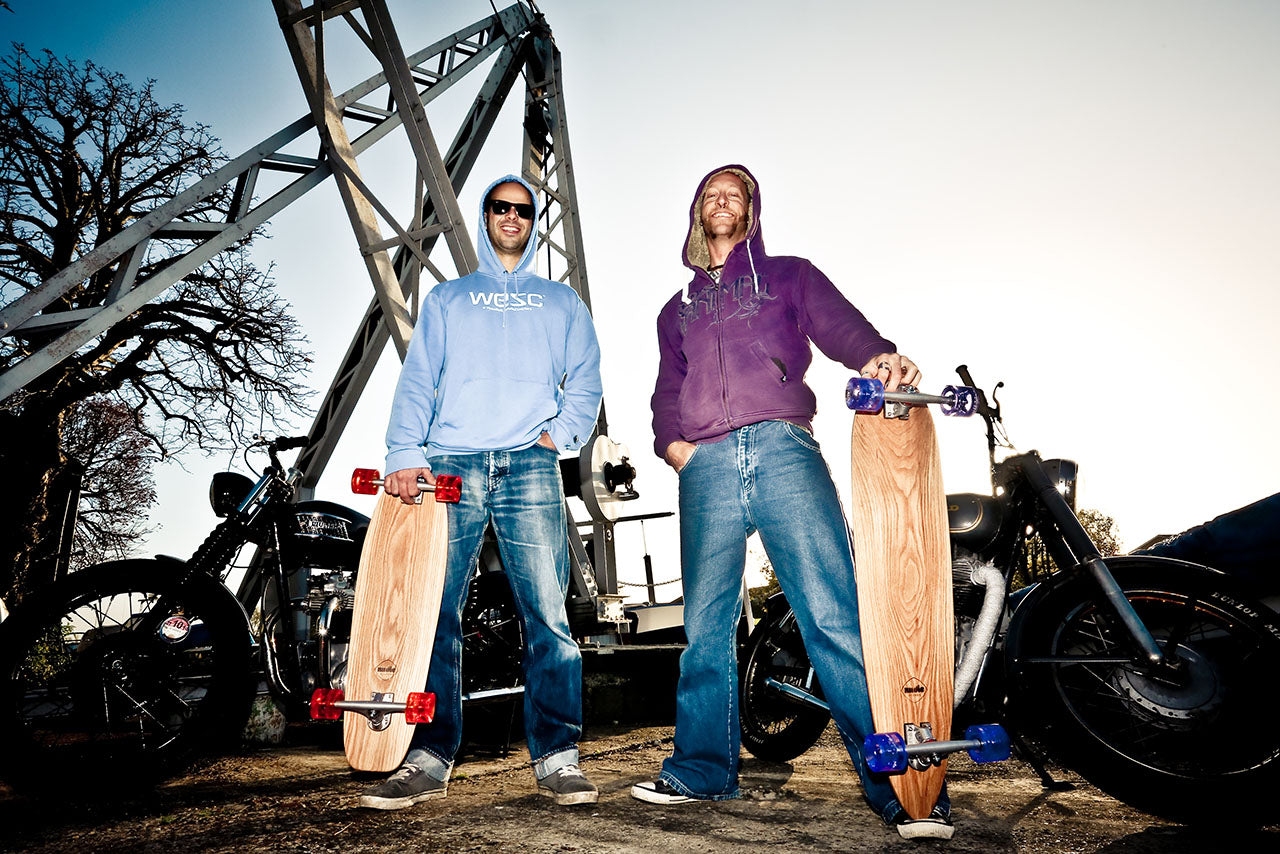 Alby and Nic with custom solid wood longboard and cruiser skateboards