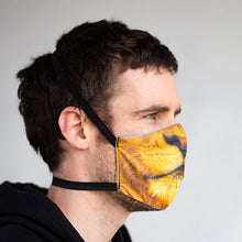 Load image into Gallery viewer, Lion art print fabric mask, on face, side view.