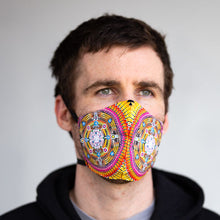 Load image into Gallery viewer, Galactivation art print fabric mask, on face, front view.