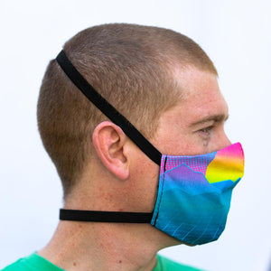 Neon Landscape art print fabric mask, on face, side view.