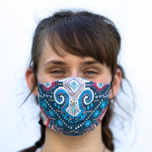 Load image into Gallery viewer, Argylish art print fabric mask, on face, front view.