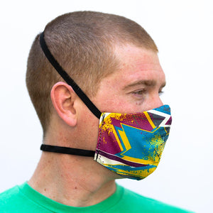 Bam! art print fabric mask, on face, side view.