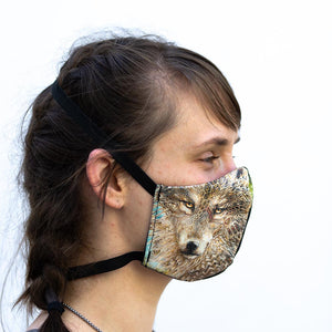 Wolf art print fabric mask, on face, side view.