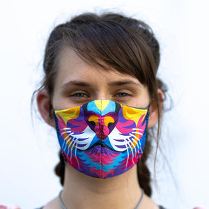 Color Lion art print fabric mask, on face, front view.