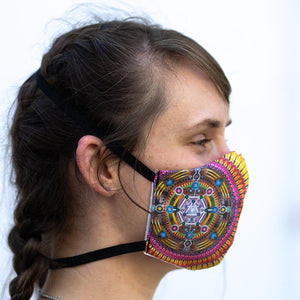 Galactivation art print fabric mask, on face, side view.