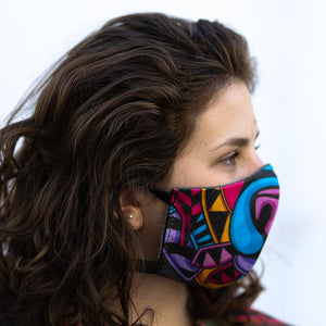 Color Bear art print fabric mask, on face, side view.