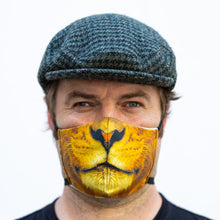 Load image into Gallery viewer, Lion art print fabric mask, on face, front view.