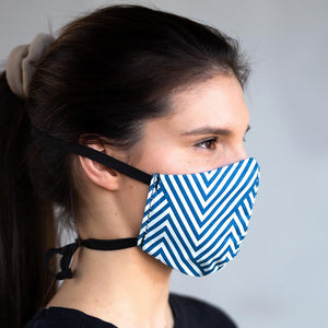 Blue Chevron art print fabric mask, on face, side view.